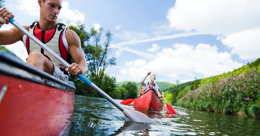 canoeing is family friendly. photo of two people in separate canoe